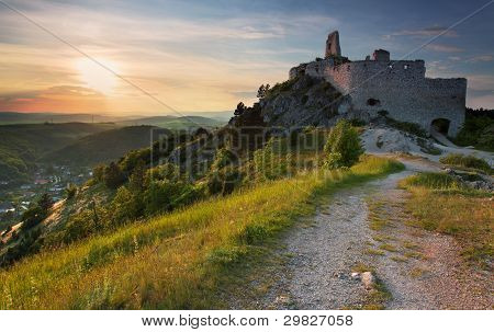 Ruin of castle with sun