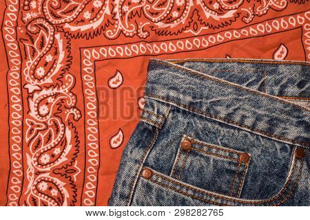 Classic Jeans With Five Pockets Close-up. Paisley Patterned Bandana, Classic Orange And White Necker