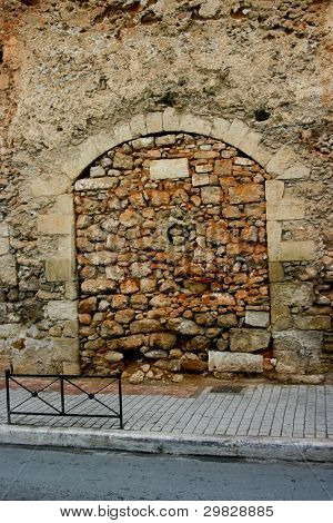 Ancient door  closed by stones