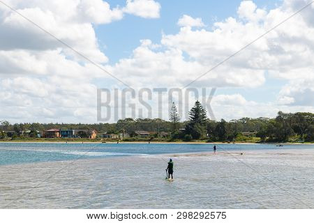 Fishermen Enjoying The Sunny Weather In The Small Fishing Village Of Crowdy Head, Famous For The Bre
