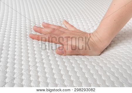 Woman Is Choosing New Mattress For Good Sleeping