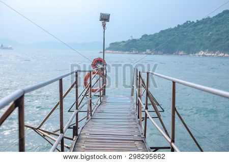 Area of Photographer name Sai Wan Swimming Shed located in Kennedy town with offshore step into the sea. One of destination in Hongkong island. poster