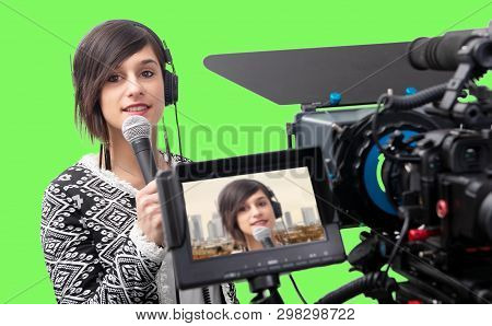 Pretty Young Woman  Journalist Presenting Report In Television Studio On Green Screen