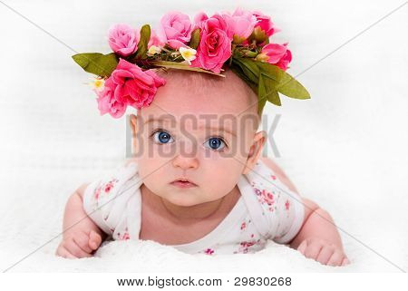 a large portrait of a cute little girl with a beautiful flower