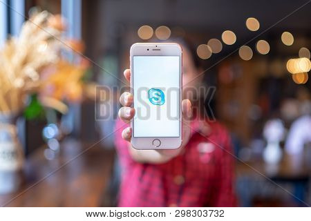 Chiang Mai, Thailand - Apr.08,2019: Woman Holding Apple Iphone 6s Rose Gold With Skype Apps. Skype I