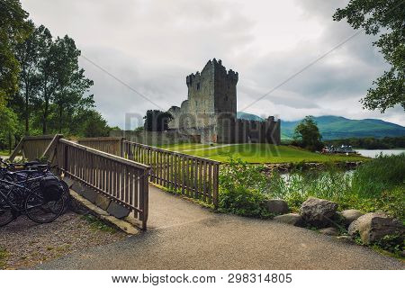 Path And Footbridge Leading To Ross Castle In The Killarney National Park, Ireland.