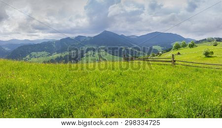 Carpathian Landscape. Fenced Hayfields On A Foreground, Distant Mountain Ranges On A Background Of C