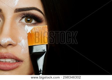 Close Up Beauty Portrait Of Beautiful Woman Applying Face Cream. Beautiful Young Woman With Clean Pe