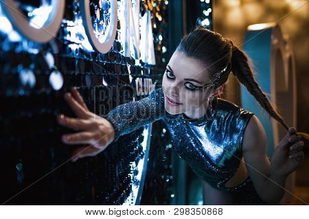 Gorgeous Young Girl In A Stage Image. Striptease, Dancing On The Pylon. Portrait Photo