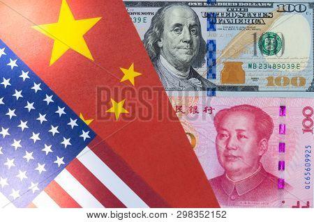 Us Dollar And Yuan Banknote On Usa And China Flags. Its Is Symbol For Tariff Trade War Crisis Betwee