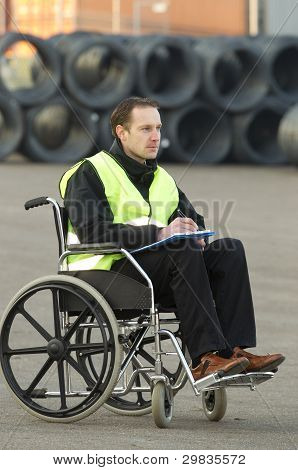 Disabled Supervisor Updating His Checklist