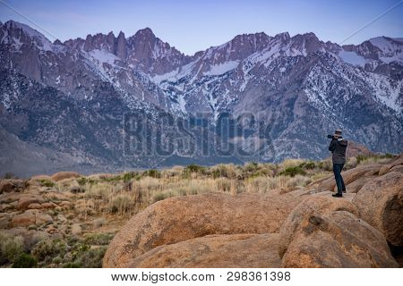 Asian Man Photographer And Tourist Taking Photo Of Mount Whitney Landscape At Dawn From Alabama Hill
