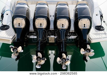 Four Outboard Motors On A Speed Boat