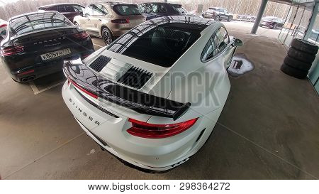 Moscow, Russia - April 29, 2019: White Matte Porsche 911 Turbo In Exclusive Wide And Carbon Body Kit