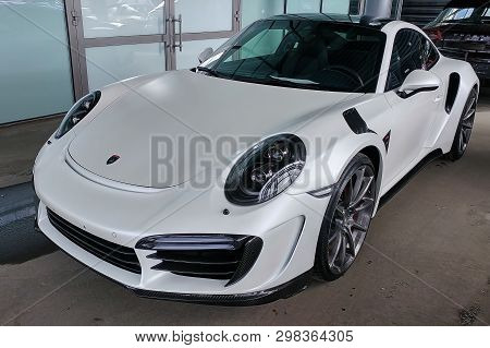 Moscow, Russia - April 29, 2019: Exclusive White Matte Porsche 911 Turbo In Exclusive Wide And Carbo
