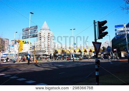 Daily City Chaos In The Hectic And Modern Station Of The Metropolis Of Rotterdam. Yellow Cubic House