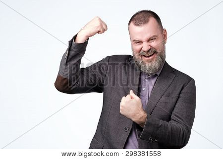 Positive Mature Guy Showing His Success Boasting.