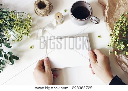Floral Lifestyle Composition. Mockup Scene With Mums Flowers, Greenery And Cup Of Coffee On White Ta