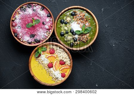 Smoothie Bowls. Healthy Breakfast Bowl With Chia Seeds, Muesli, Berries, Fruits And Coconut Flakes C