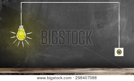 Chalk Drawing Of Glowing Light Bulb And Switch On Blackboard Symbolizing An Idea Or Innovation
