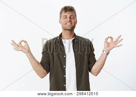 Guy Reaching Nirvana Feeling Happy And Relaxed Released From Stress Meditating With Closed Eyes, Bro