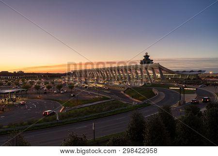 Washington Dulles, Usa - 10 April 2019: Washington Dulles International Airport Is Floodlit At Dawn