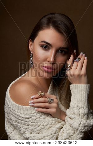 Beautiful Young Brunette Woman In Warm Knitted White Sweater