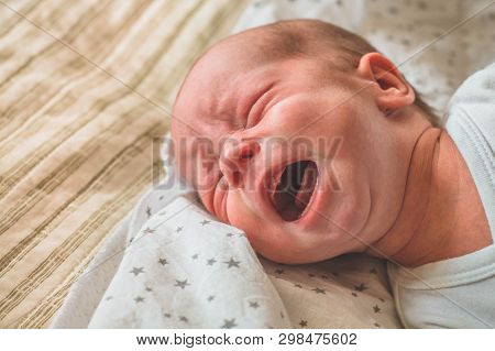 Crying Hungry Newborn Baby Lying On The Bed. Love Baby. Newborn Baby And Mother.