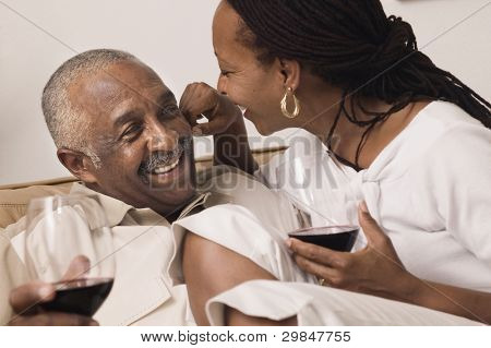 Couple hugging and drinking wine