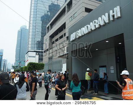 Jakarta, Indonesia - April 7, 2019: Crowd Of People At The Entrance Gate Of Bundaran Hi Mrt Station
