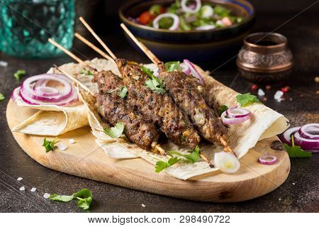 Lula Kebab From Minced Meat (beef, Lamb, Veal) On Pita Bread (lavash), Shish Kebab. With Red Onion,