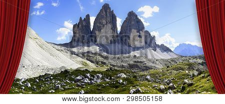 Open Theater Red Curtains Against The Tre Cime Di Lavaredo Panoramic View In Summer - Dolomitics Lan