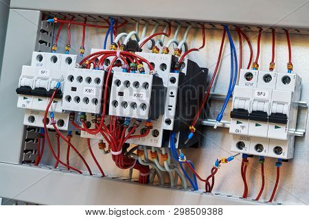 Two Contactors With Additional Contacts And Modular Circuit Breakers On The Mounting Panel In The El