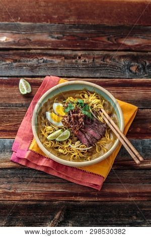 Malay Mee Rebus With Beef, Eg And Onion In A Bowl, Copy Space