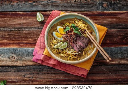 Bowl Of Boiled Noodles With Sweet Potato Gravy, Malaisan Cuisine Mee Rebus, Copy Space.