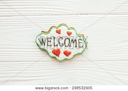 Welcome home sign cookie on white wood, flat lay with space for text. Dream home concept. Home Sweet Home. Moving in new house poster