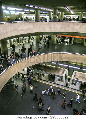 Sao Paulo, Brazil, August 28, 2003. Trains And Passengers At The Se Subway Station, Is The Central A