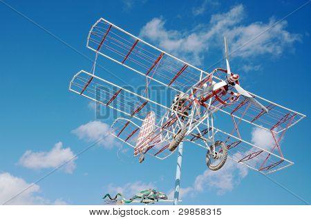 Old model of plane in the sky