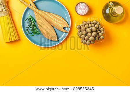Spaghetti, Shimeji Mushroom, Olive Oil,  Pink Salt, Empty Ceramic Bowl, Wooden Spoons For Salad Over