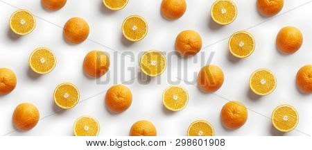 Tropical Abstract Background. Orange Fruit On The White Background