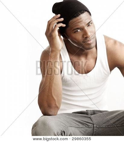 Studio portrait of a good looking young black man against neutral background with copy space