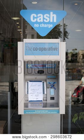 Co-operative Bank Atm With An Out Of Service Sign On The High Street In The Town Of St Pierre Port (