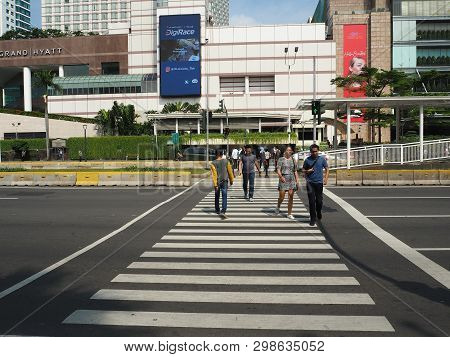 Jakarta, Indonesia - April 17, 2019: The Pelican Crossing On Jalan Thamrin Around Bundaran Hotel Ind