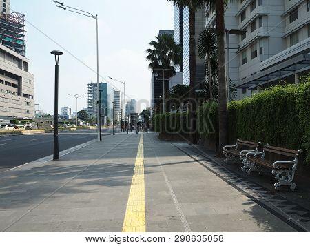 Jakarta, Indonesia - April 17, 2019: Pedestrian Sidewalk On Thamrin Street With Background Of Modern