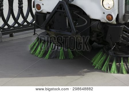 Detail Of A Street Sweeper Machine, car Cleaning The Road poster