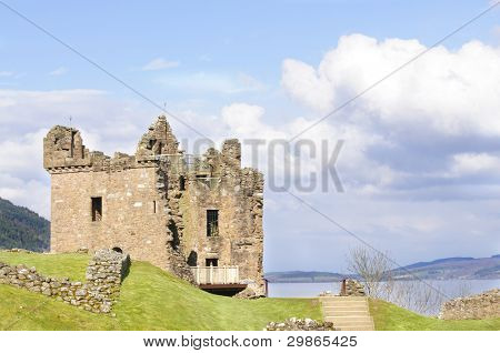 """Urquhart Castle on Loch Ness in Scotland the home of the clan Grant, and the place of the most sightings of """"Nessy"""" the famous Loch Ness monster"""