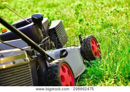 Lawn Mower, Mowing Green Grass, Lawn Care.