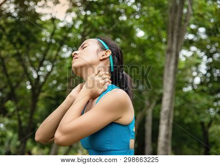 Woman Wearing Exercise Suit,put Hands Touch Her Neck,a Stiff Neck From Exercise,relieve Pain,uncomfo