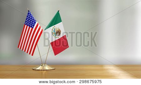 3d Illustration. American And Mexican Flag Pair On A Desk Over Defocused Background