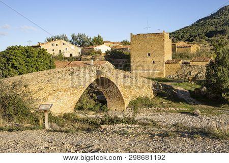 Ancient Bridge Over Las Truchas River In Pobleta De San Miguel Village, Villafranca Del Cid, Provinc